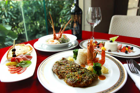 Enjoy Special Land & Sea set, inclusive of a bottle of Red Wine, right in your Cozy Home meal